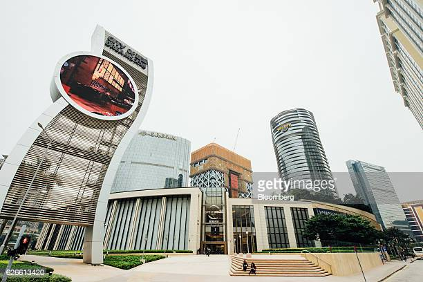 Morpgeus Melco Crown Entertainment Ltd's new hotel tower center stands under construction at the company's City of Dreams casino resort in Macau...