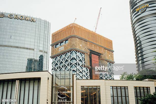 Morpheus Melco Crown Entertainment Ltd's new hotel tower center stands under construction at the company's City of Dreams casino resort in Macau...
