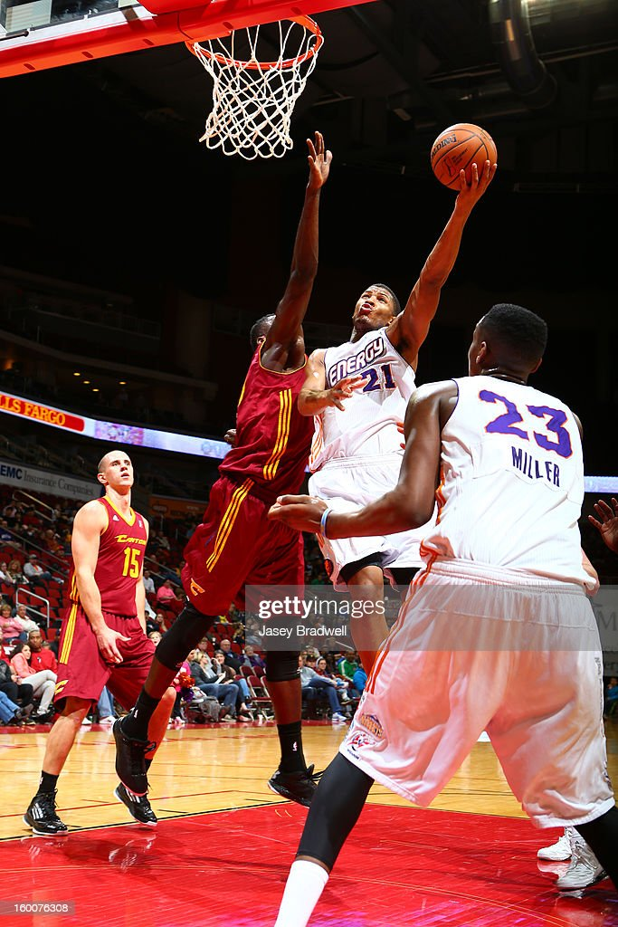 Morris Almond #21 of the Iowa Energy tries to lay it in against the Canton Charge in an NBA D-League game on January 25, 2013 at the Wells Fargo Arena in Des Moines, Iowa.
