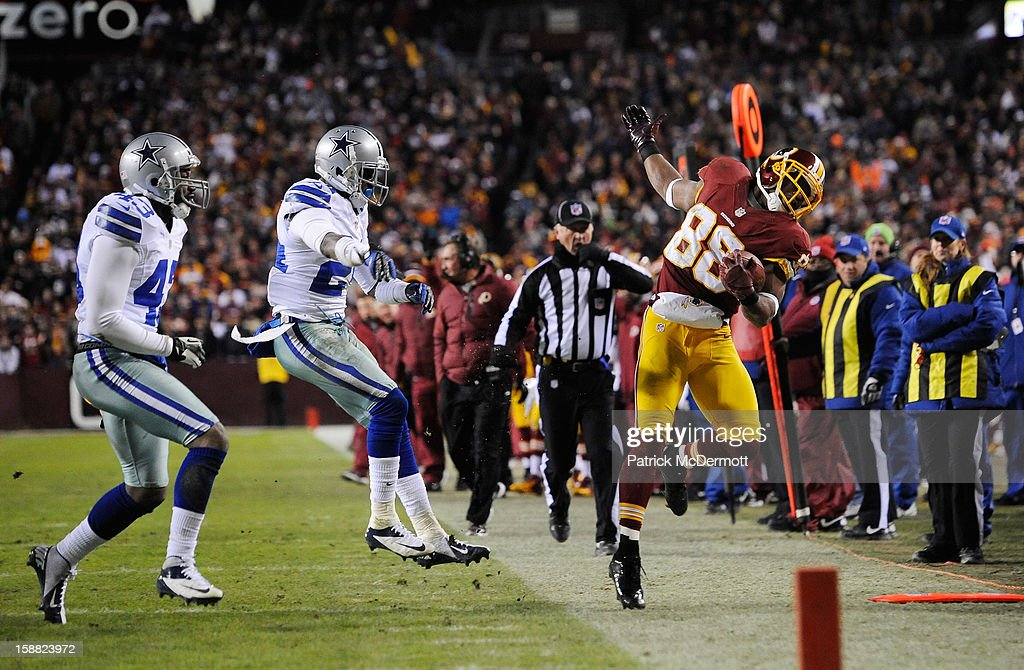 Morris Claiborne #24 of the Dallas Cowboys pushes Pierre Garcon #88 of the Washington Redskins out of bounds after Garcon caught a pass in the third quarter at FedExField on December 30, 2012 in Landover, Maryland.