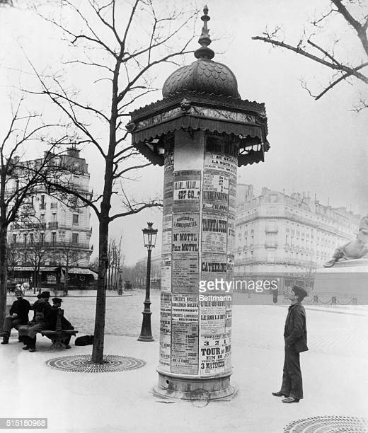A 'Morris Column' covered with poster advertisements at Place DenfertRocheran in Paris Undated photograph BPA