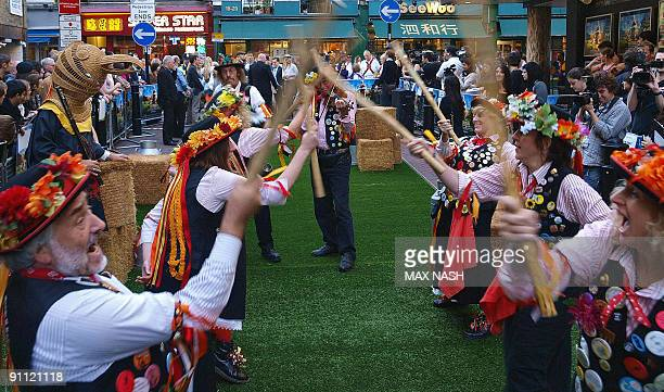 Morris Dancers perform at the film Premiere of 'Morris A Life With Bells' on September 24 2009 in Central London AFP PHOTO/ MAX NASH