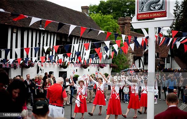 Morris dancers perform traditional English folk dances at the Ightham medieval Coxcombe Fair to celebrate Queen Elizabeth II's Diamond Jubilee on...