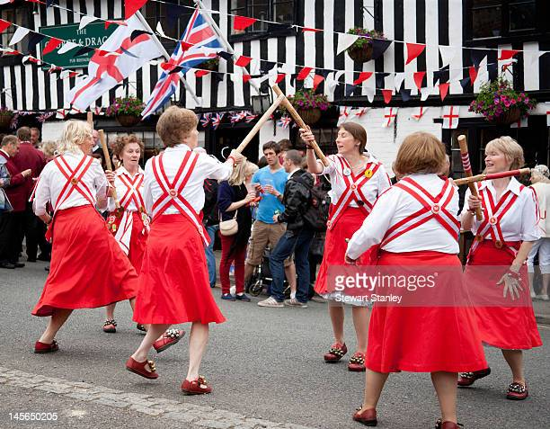 Morris dancers perform traditional English folk dances at the Ightham medieval Coxcombe Fair to celebrate Queen Elizabeth II's Diamond Jubilee at...