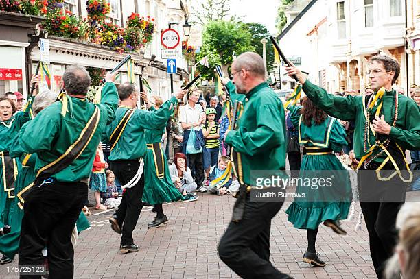 Morris Dancers performs in `mrket Square on Day 5 of Sidmouth Folk Week on August 6 2013 in Sidmouth England