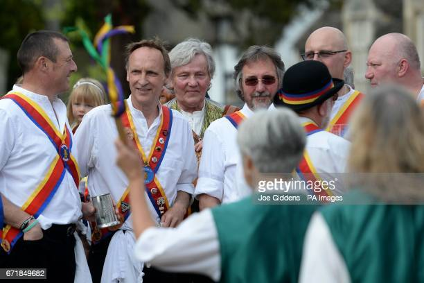 Morris dancers watch the Molly dancers performing as people celebrate St George's Day and the official start of the asparagus season at the The...