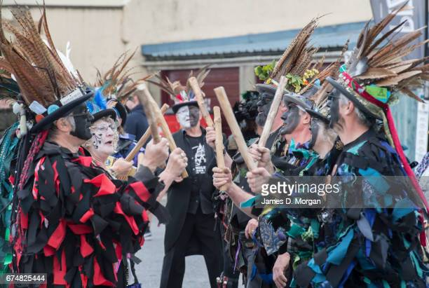 Morris dancers with their faces painted black as part of a traditional disguise perform the Green Man Spring Festival on April 29 2017 in Bovey...