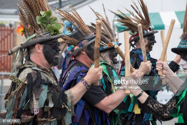 Morris dancers with their faces painted black as part of a traditional disguise perform at the Green Man Spring Festival on April 29 2017 in Bovey...