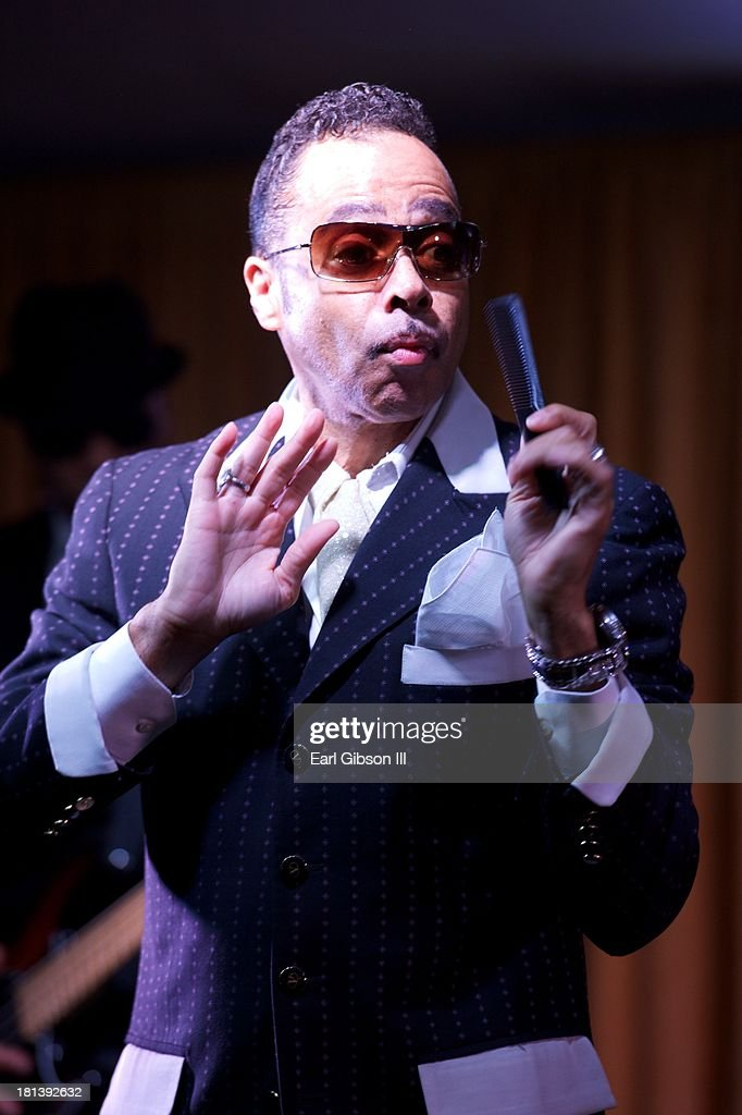 <a gi-track='captionPersonalityLinkClicked' href=/galleries/search?phrase=Morris+Day&family=editorial&specificpeople=2526136 ng-click='$event.stopPropagation()'>Morris Day</a> performs at the 'Motown Live' The Michigan CBC Delegation Reception on Day 3 of the 43rd Annual Legislative Conference on September 20, 2013 in Washington, DC.