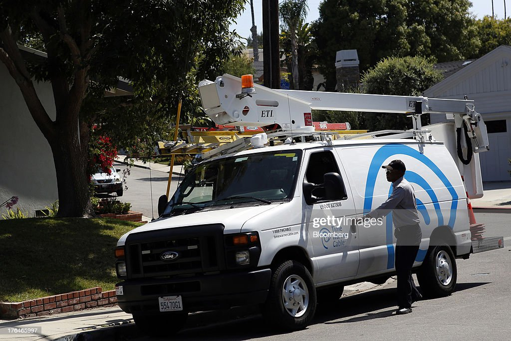 Morris Hibbitt, a field technician for Time Warner Cable, prepares to clean and check the connection for a WiFi hotspot using a bucket truck in Manhattan Beach, California, U.S., on Monday, Aug. 12, 2013. Time Warner Cable Inc. said it's talking with CBS Corp., after a breakdown in negotiations led the cable provider to block its customers from seeing the network. Photographer: Patrick Fallon/Bloomberg via Getty Images