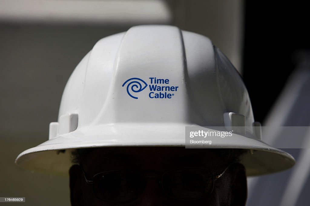 Morris Hibbitt, a field technician for Time Warner Cable, stands for a photograph while wearing a Time Warner Cable helmet in Manhattan Beach, California, U.S., on Monday, Aug. 12, 2013. Time Warner Cable Inc. said it's talking with CBS Corp., after a breakdown in negotiations led the cable provider to block its customers from seeing the network. Photographer: Patrick Fallon/Bloomberg via Getty Images