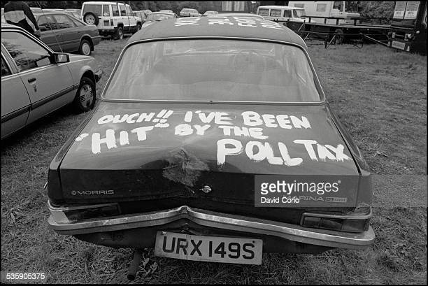 A Morris Marina adorned with graffiti about the Poll Tax in Hackney London UK 19th May 1990
