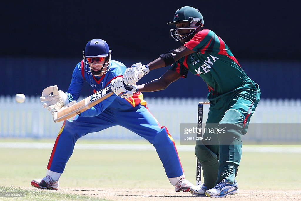 Morris Ouma of Kenya plays a shot in front of wicketkeeper JP Kotze (L) of Namibia during an ICC World Cup qualifying match between Namibia and Kenya on January 17, 2014 in Mount Maunganui, New Zealand.