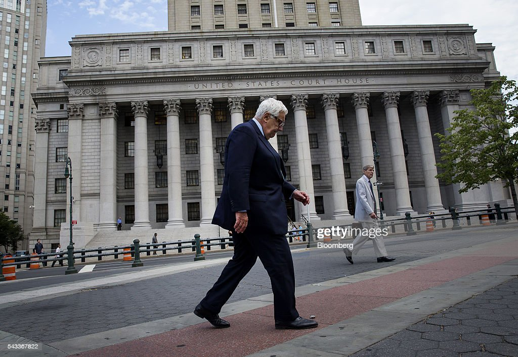 Morris Zukerman, chairman of ME Zukerman & Co., center, exits federal court in New York, U.S., on Monday, June 27, 2016. Oil-industry investor Zukerman admitted to evading tens of millions of dollars in taxes, pleading guilty to federal charges that could send him to prison for more than seven years. Photographer: Eric Thayer/Bloomberg via Getty Images