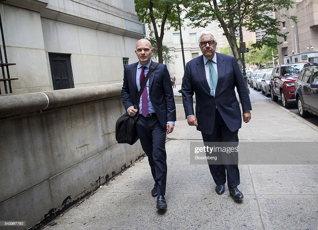 Morris Zukerman, chairman of ME Zukerman & Co., right, exits federal court in New York, U.S., on Monday, June 27, 2016. Oil-industry investor Zukerman admitted to evading tens of millions of dollars in taxes, pleading guilty to federal charges that could send him to prison for more than seven years. Photographer: Eric Thayer/Bloomberg via Getty Images
