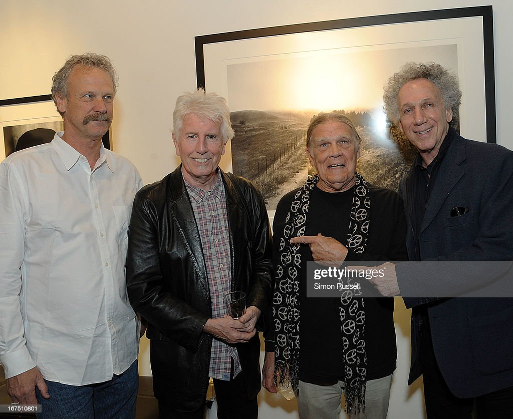 Morrison Hotel Gallery co-founder Peter Blachley, musician Graham Nash, Rock n' Roll photographers Henry Diltz and Bob Gruen attend the Graham Nash Photo Exhibit Opening at the Morrison Hotel Gallery on April 25, 2013 in New York City.