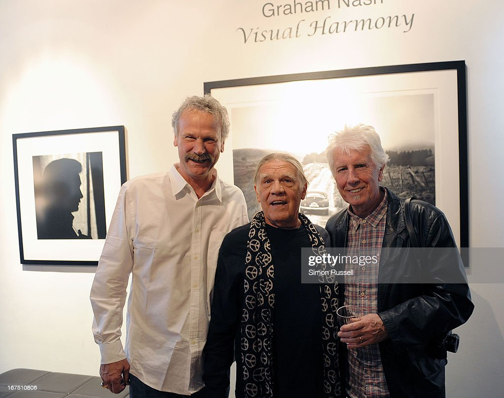 Morrison Hotel Gallery co-founder Peter Blachley, Rock n' Roll photographer Henry Diltz and musician and photographer <a gi-track='captionPersonalityLinkClicked' href=/galleries/search?phrase=Graham+Nash&family=editorial&specificpeople=208239 ng-click='$event.stopPropagation()'>Graham Nash</a> attends the <a gi-track='captionPersonalityLinkClicked' href=/galleries/search?phrase=Graham+Nash&family=editorial&specificpeople=208239 ng-click='$event.stopPropagation()'>Graham Nash</a> Photo Exhibit Opening at the Morrison Hotel Gallery on April 25, 2013 in New York City.