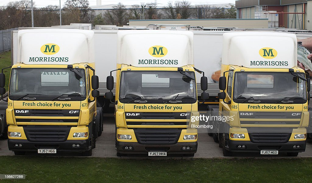 WM Morrison Supermarkets Plc-branded trucks sit outside the company's distribution center in Wakefield, U.K., on Thursday, Nov. 22, 2012. Britain's economy will return to growth next year after stagnating in 2012, with expansion weighted in the second half, according to Bank of England projections published yesterday. Photographer: Simon Dawson/Bloomberg via Getty Images