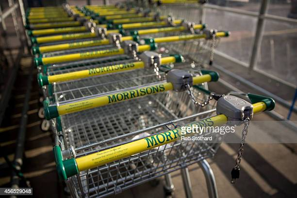 Morrisons logos adorn trolleys outside a branch of the supermarket chain on October 2 2014 in London England Morrisons who reported a fall in...