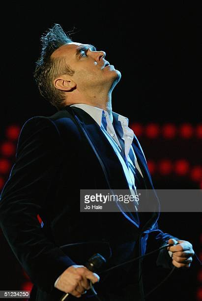 Morrissey performs on stage on the second day of 'The Carling Weekend Reading Festival' on August 28 2004 in Reading England The festival takes place...
