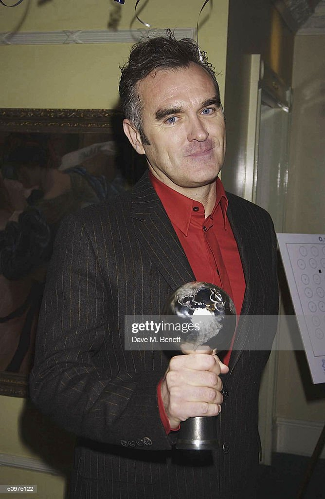 Morrissey poses with his O2 Silver Clef Award at the Nordoff-Robbins O2 Silver Clef Awards at the Inter-Continental Hotel on June 18, 2004 in London.