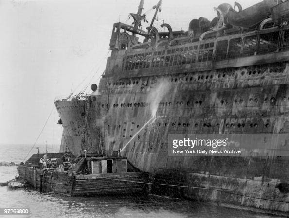 S Morro Castle disaster in Spring Lake New Jersey Tons of water are poured into Morro Castle from barge