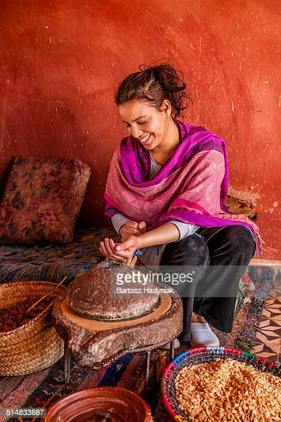 Morrocan women grind nuts to make argan oil