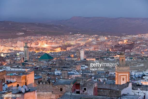 Morrocco, Fez, Medina, cityscape illuminated at dusk, elevated view