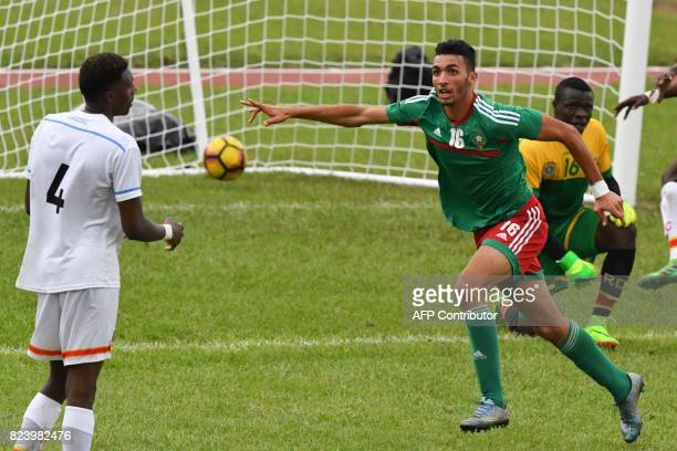 Morroco's Hamza Hannouri celebrates scoring in the semifinal football match between Morroco and the Democratic Republic of Congo at the Felix...