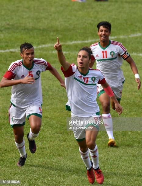 Morroco's players Badr Gaddarine Sofiane Kiyine and Zakaria Nassik celebrates a goal during the 8th Francophonie Games final football match between...