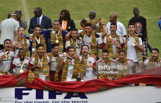 Morroco's players celebrates with they gold medals after winning the 8th Francophonie Games final football match between Ivory Coast and Morocco on...