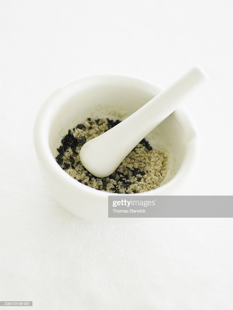 Mortar and pestle with sea salt and black salt, elevated view : Stock Photo