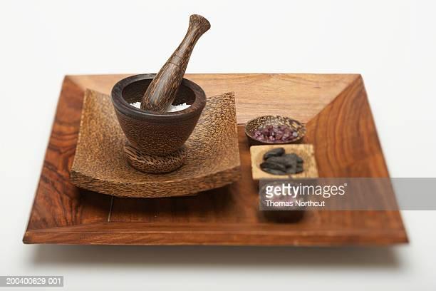 Mortar and pestle with sea salt, tourmaline, tonka beans and rosebuds