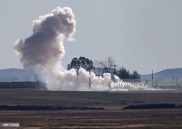A mortar fired by troops from the Syrian Democratic Forces explodes near an ISIL positions on the frontline on November 11 2015 near Hasaka in the...