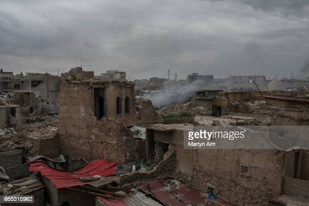 Mortar shells fired by Islamic State militants hit buildings in Bab alTob a neighbourhood in the Old City of west Mosul part of the offensive to...