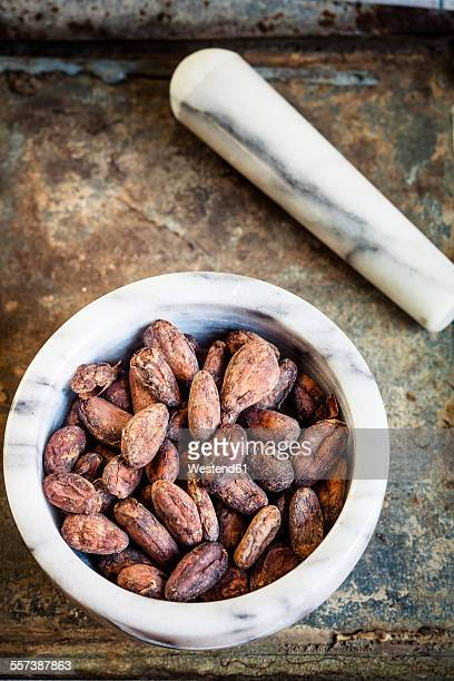 Mortar with cocoa beans