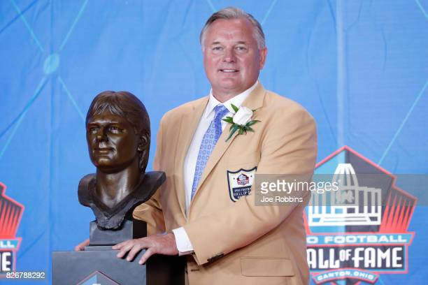 Morten Andersen poses with his bust during the Pro Football Hall of Fame Enshrinement Ceremony at Tom Benson Hall of Fame Stadium on August 5 2017 in...