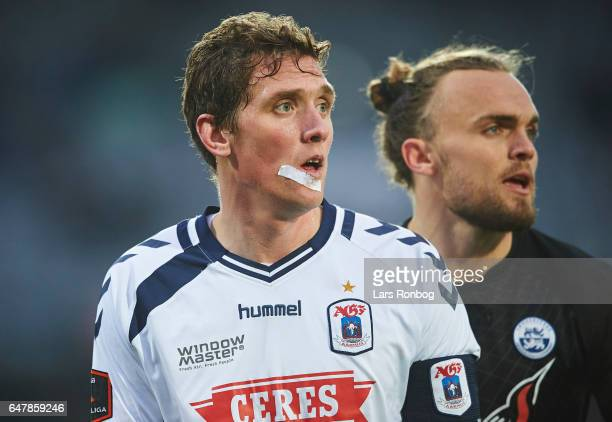 Morten Duncan Rasmussen head coach of AGF Aarhus and Pierre Kanstrup of Sonderjyske looks on during the Danish Alka Superliga match between AGF...