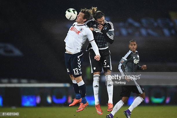 Morten Duncan Rasmussen of AGF Aarhus and Erik Johansson of FC Copenhagen compete for the ball during the Danish Alka Superliga match between AGF...