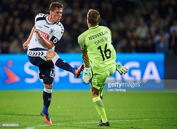 Morten Duncan Rasmussen of AGF Aarhus and Goalkeeper Johan Dahlin of FC Midtjylland compete for the ball during the Danish Alka Superliga match...