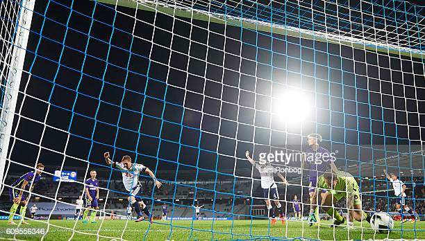 Morten Duncan Rasmussen of AGF Aarhus scores the 10 goal against Goalkeeper Johan Dahlin of FC Midtjylland during the Danish Alka Superliga match...
