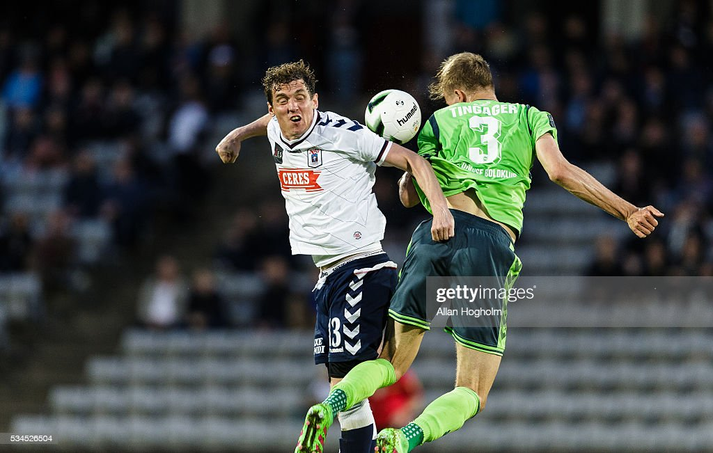 Morten Duncan Rasmussen of AGF and Frederik Tingager of OB compete for the ball during the Danish Alka Superliga match between AGF Aarhus and OB Odense at Ceres Park on May 26, 2016 in Aarhus, Denmark.