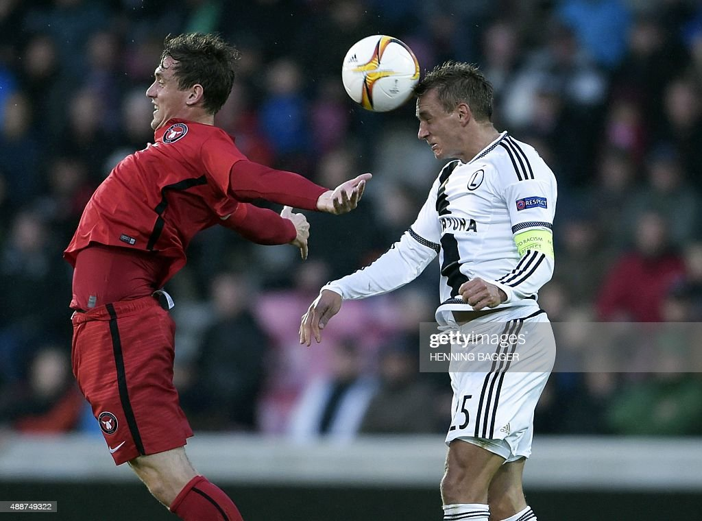 Morten Duncan Rasmussen of FC Midtjylland and Jakub Rzezniczak of Legia Warszawa vie for the ball during the UEFA Europa League Group D football...