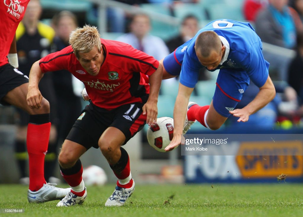 Morten Gamst Pedersen of the Rovers tackles Jason Roberts of Rangers complete for the ball during the pre-season friendly match between Blackburn Rovers and Glasgow Rangers at the Sydney Football Stadium on July 25, 2010 in Sydney, Australia.