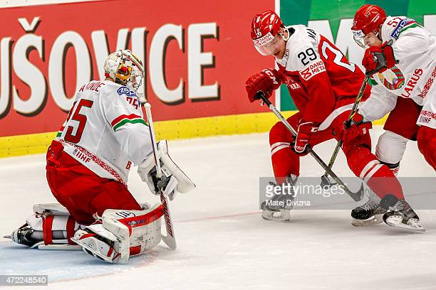 Morten Madsen of Denmark tries to score against Kevin Lalande goalkeeper of Belarus during the IIHF World Championship group B match between Denmark...