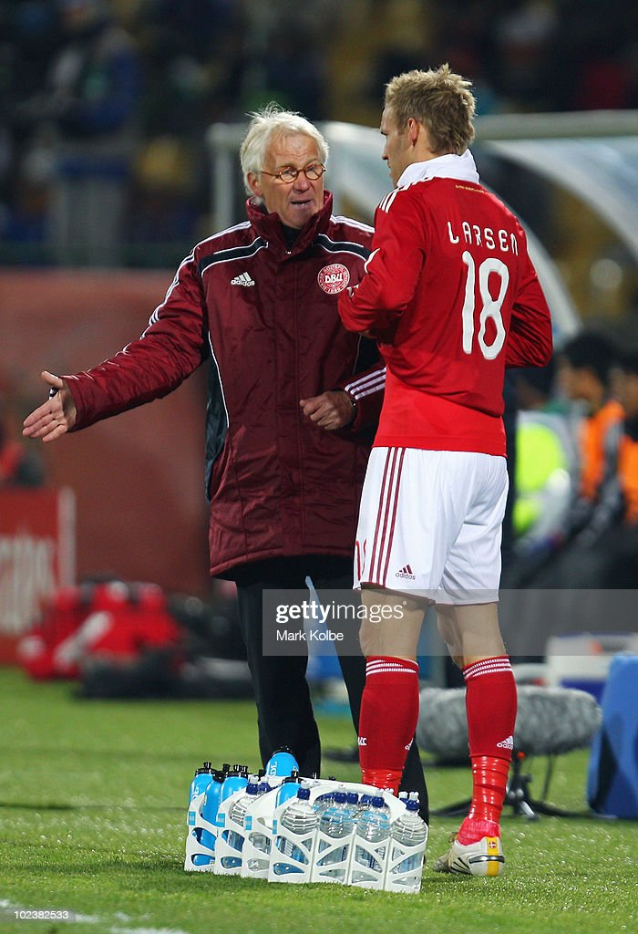 Morten Olsen head coach of Denmark instructs Soren Larsen of Denmark as he comes on as a substitute during the 2010 FIFA World Cup South Africa Group...