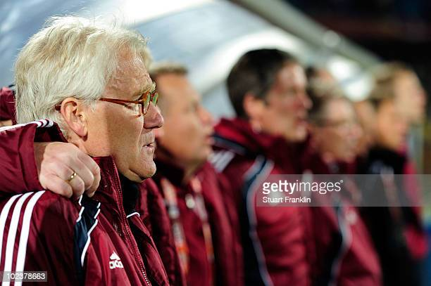 Morten Olsen head coach of Denmark lines up for the national anthems prior to the 2010 FIFA World Cup South Africa Group E match between Denmark and...