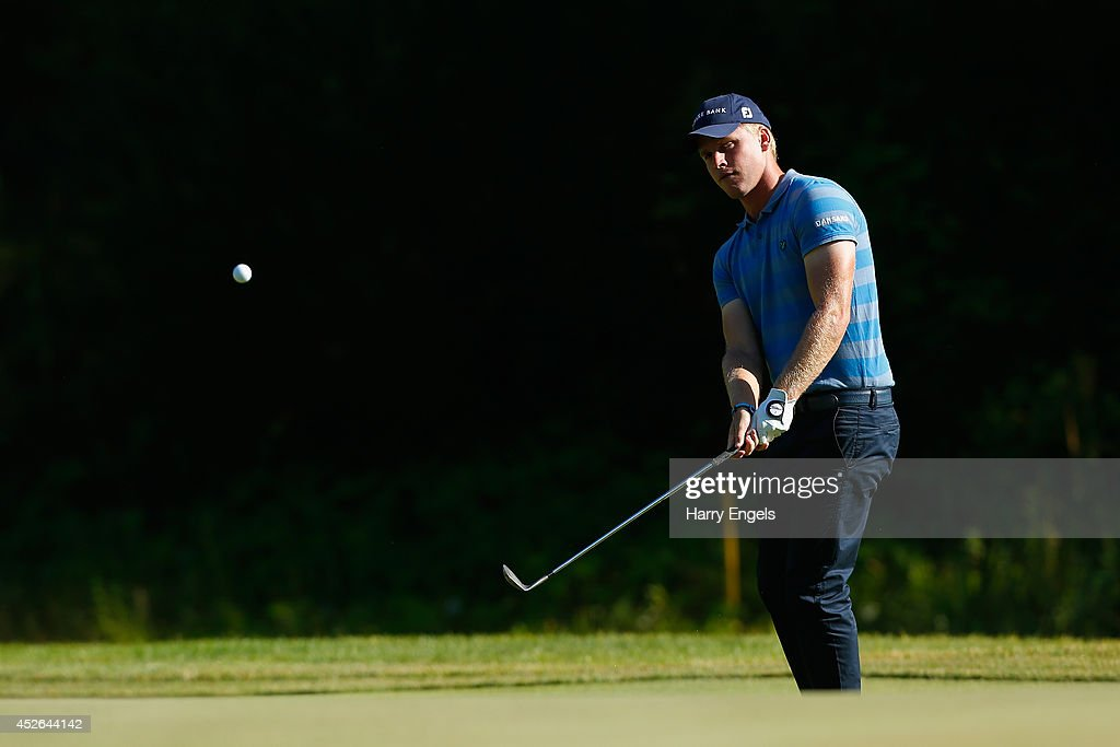 Morten Orum Madsen of Denmark chips onto the green at the tenth on day two of the M2M Russian Open at Tseleevo Golf & Polo Club on July 25, 2014 in Moscow, Russia.