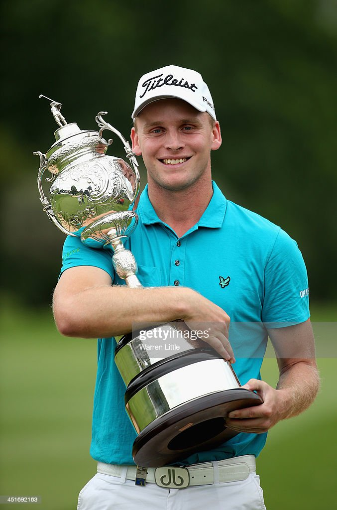 Morten Orum Madsen of Denmark poses with the trophy after winning the South African Open Championship at Glendower Golf Clubon a score of -19 under par on November 24, 2013 in Johannesburg, South Africa.