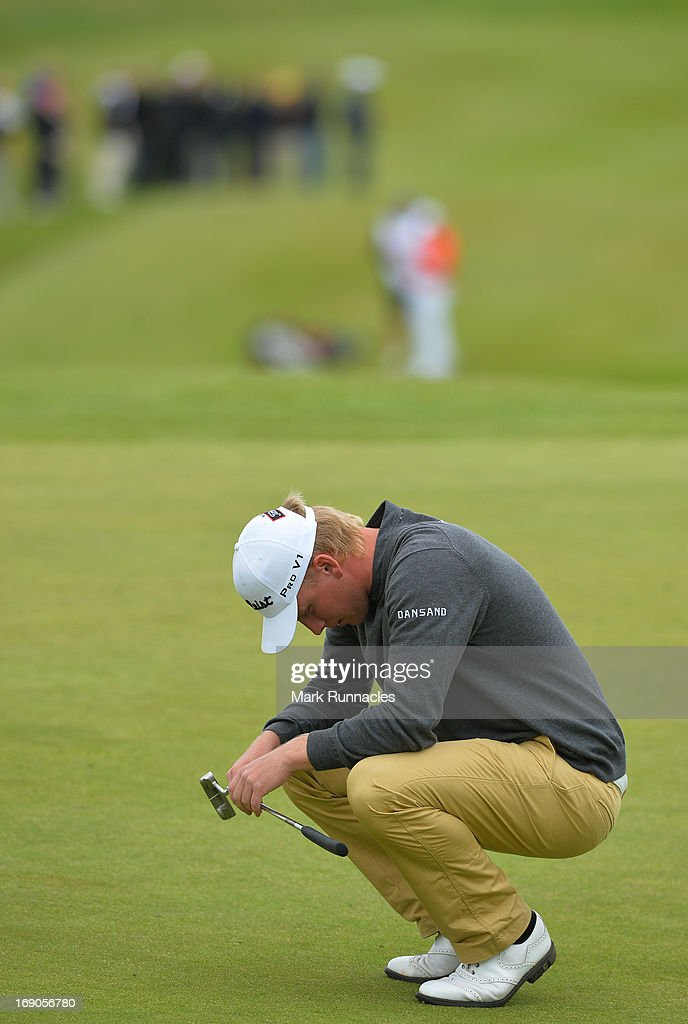 Morten Orum Madsen of Denmark reacts on the 18th green during the final round of the Madeira Islands Open - Portugal - BPI at Club de Golf do Santo da Serra on May 19, 2013 in Funchal, Madeira, Portugal.